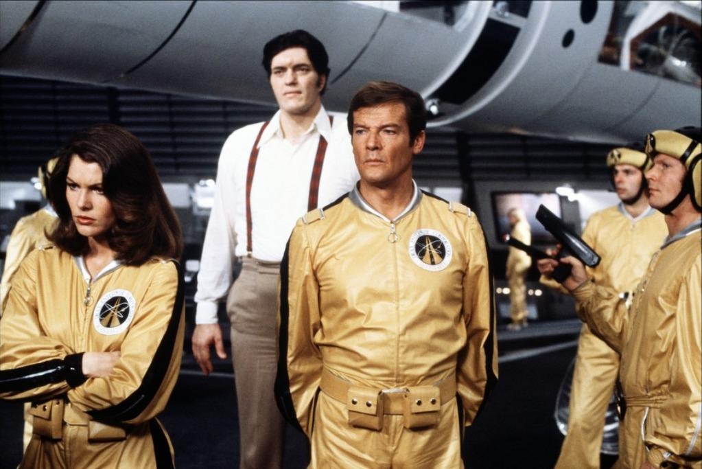 Roger Moore, centre, starring as James Bond in Moonraker.