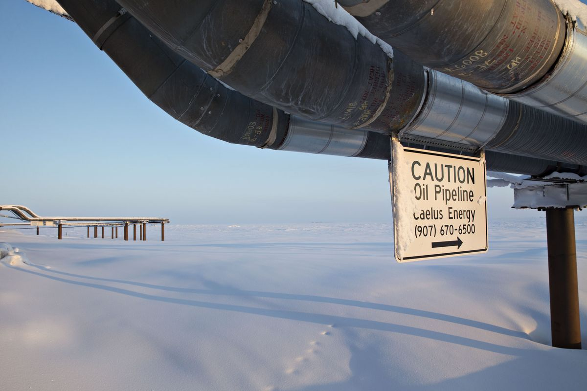 A caution sign hangs from an oil pipeline at the Caelus Energy LLC Oooguruk Development Project on the North Slope in Harrison Bay, Alaska, U.S., on Friday, Feb. 17, 2017.  Photographer: Daniel Acker/Bloomberg