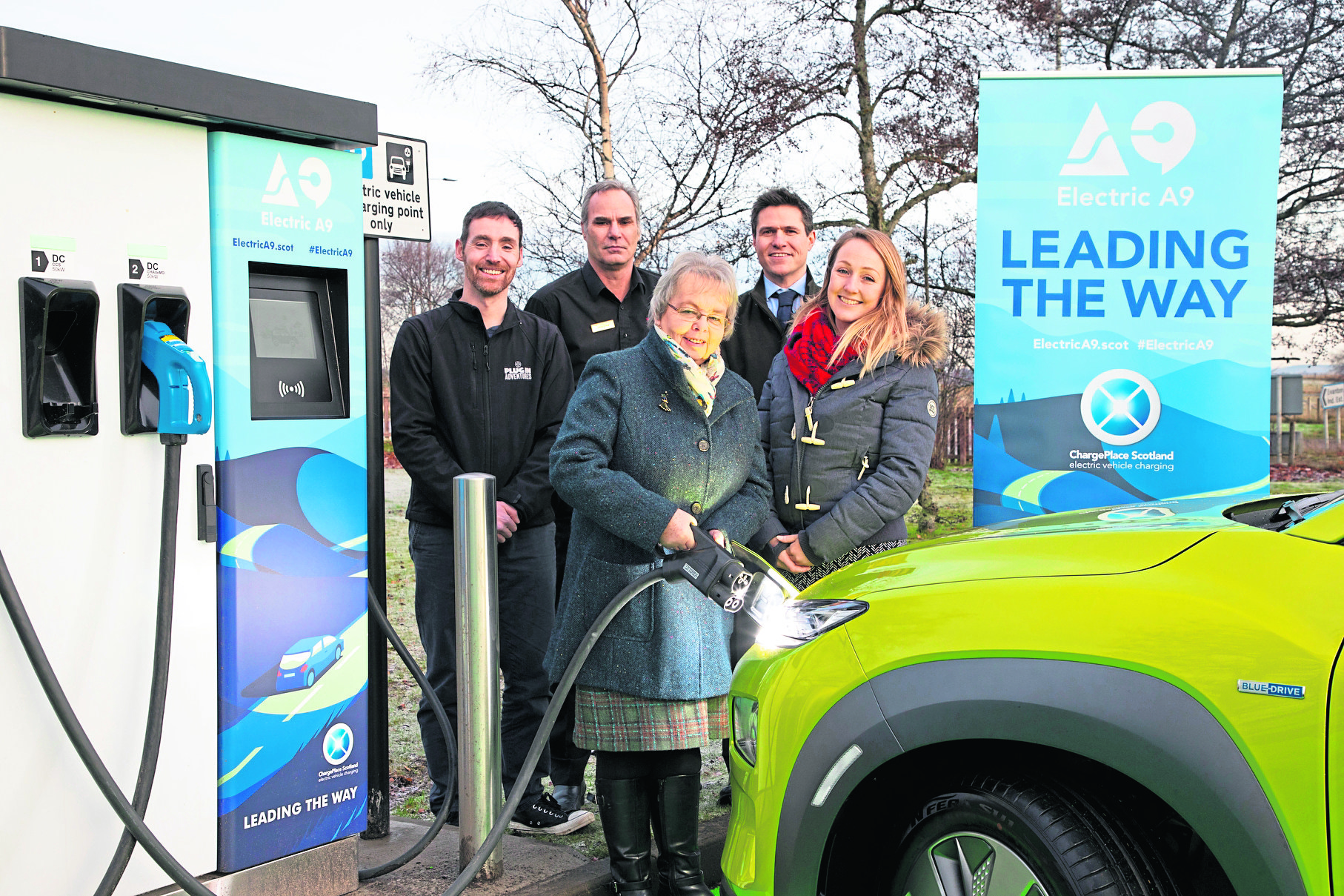 L-R Chris Ramsey, Trevor Wilson, Councillor Trish Robertson, Stephen Rennie, Ellie Grebenick  A9 Electric vehicle charger