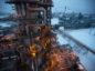Electrical light illuminates a petroleum cracking tower at the Lukoil-Nizhegorodnefteorgsintez oil refinery, operated by OAO Lukoil, in Nizhny Novgorod, Russia. Photographer: Andrey Rudakov/Bloomberg