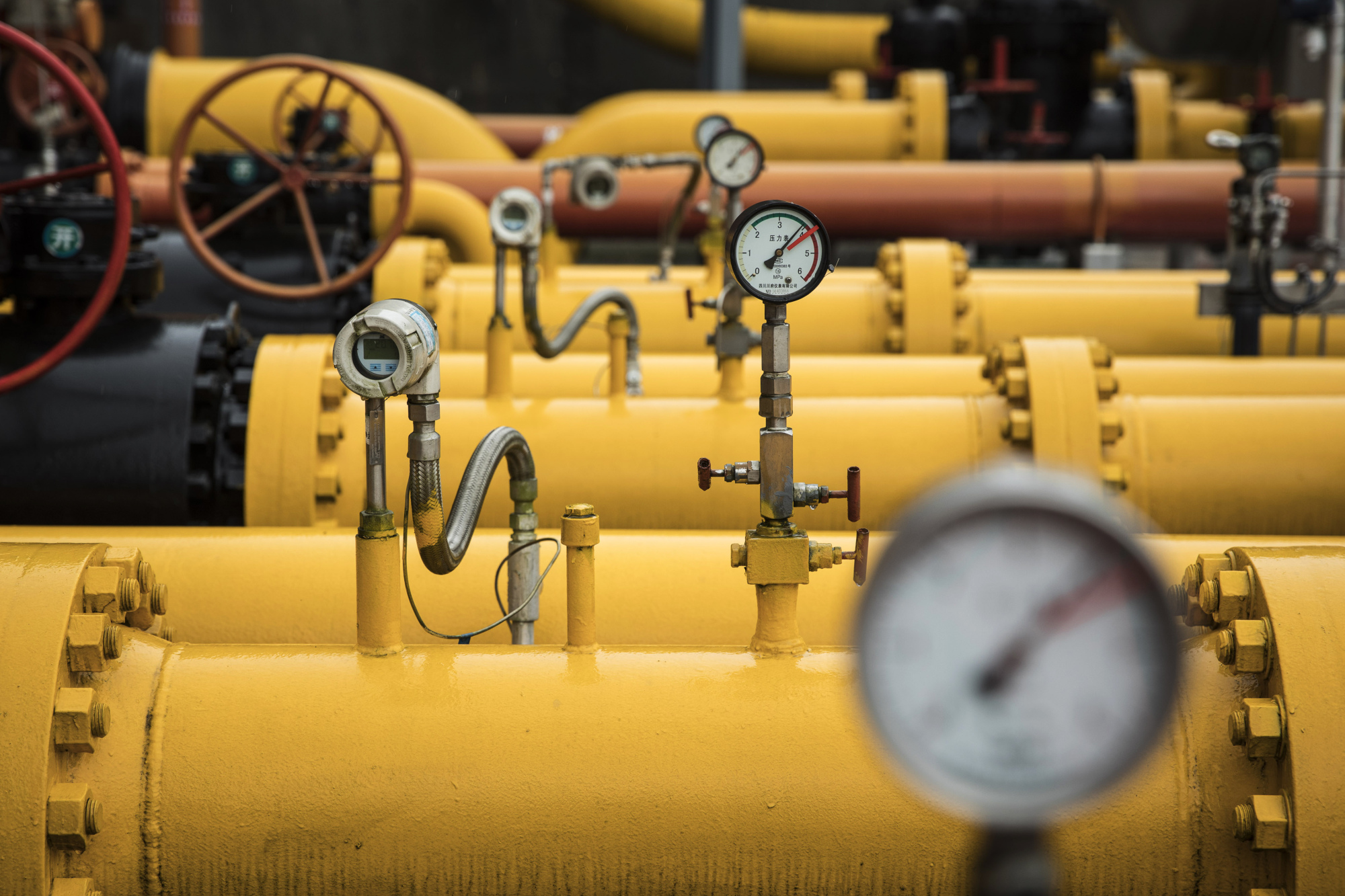 Pressure gauges sit on pipework at a shale gas collection and transfer facility at the Fuling shale gas project site, operated by Sinopec Chongqing Fuling Shale Gas Exploration and Development Co., a unit of China Petrochemical Corp. (Sinopec), in Jiaoshiba, Chongqing Municipality, China.