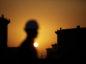 The sun sets over crude oil storage tanks at the Juaymah tank farm, operated by Saudi Aramco, in Ras Tanura, Saudi Arabia. Photographer: Simon Dawson/Bloomberg
