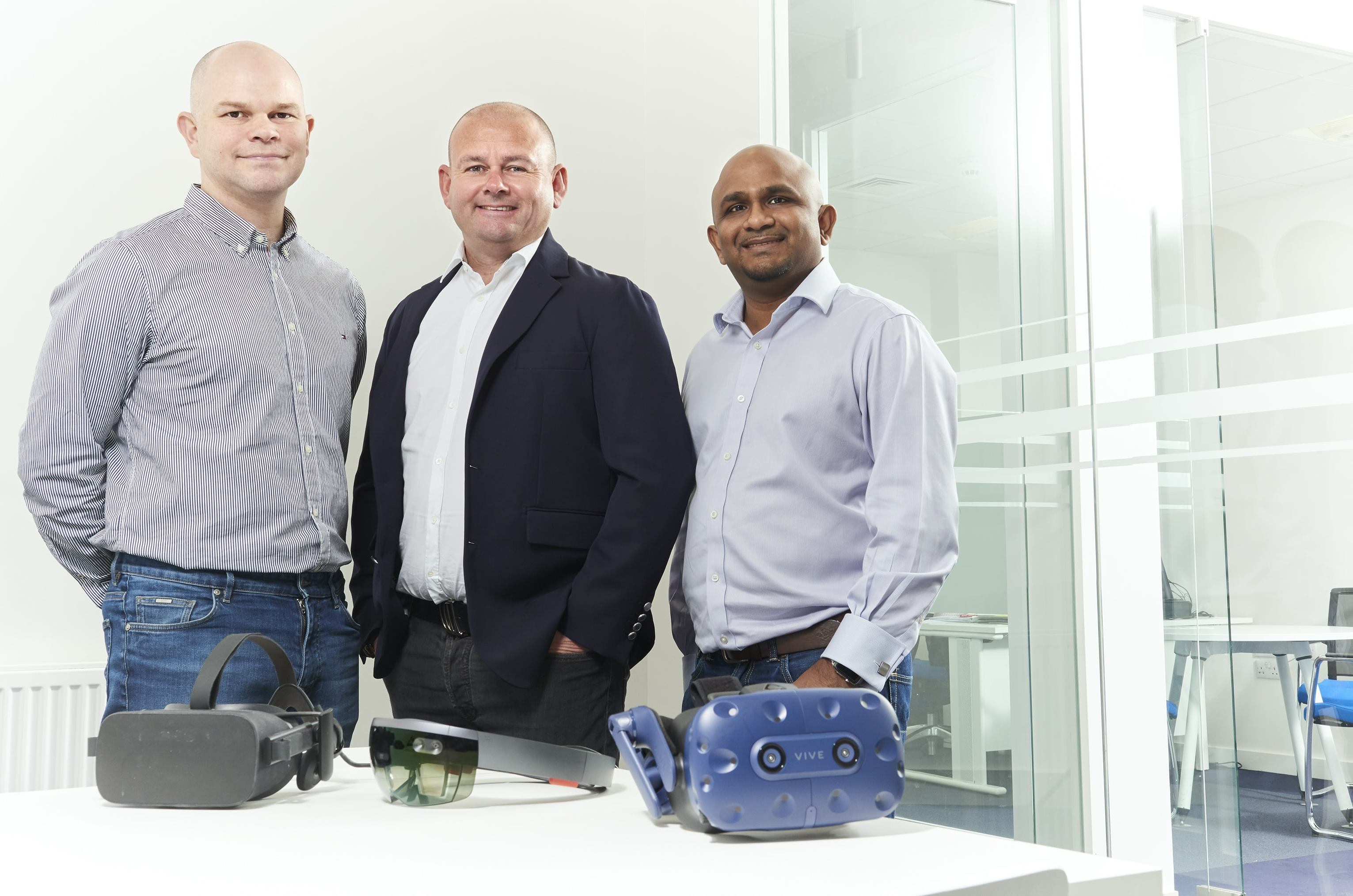 Left to right Richard Coates Paul Stonebanks OBE and Dinesh Kumar celebrate 3T Energy Group's acquisition of Neutron.