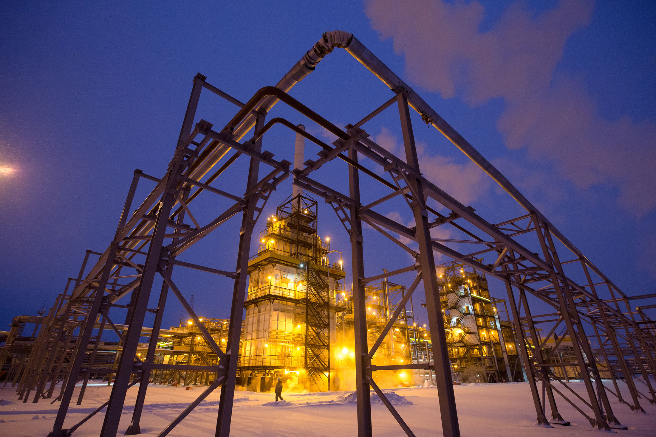Lights illuminate the low-temperature isomerization unit at the Novokuibyshevsk oil refinery plant, operated by Rosneft PJSC, in Novokuibyshevsk, Samara region, Russia, on Wednesday, Dec. 21, 2016.