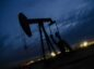 A pump jack stands at dusk in the Permian Basin area of Loving County, Texas, U.S., on Sunday, Dec. 16, 2018. Once the shining star of the oil business, gasoline has turned into such a drag on profits that U.S. refiners could be forced to slow production in response. Photographer: Angus Mordant/Bloomberg