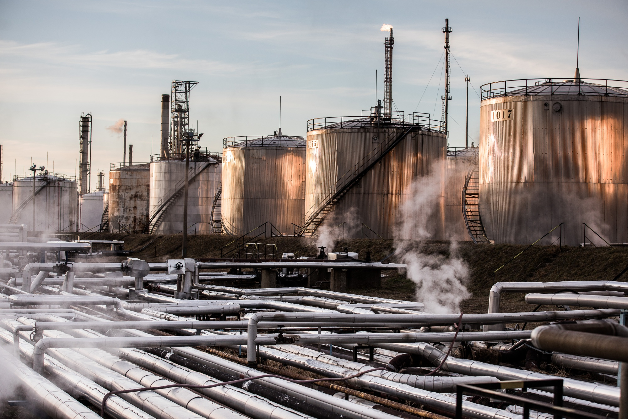Storage tanks stand in the Duna oil refinery, operated by MOL Hungarian Oil & Gas Plc, in Szazhalombatta, Hungary, on Monday, Feb. 13, 2019. Oil traded near a three-month high as output curbs by OPEC tightened global supply while trade talks between the U.S. and China lifted financial markets. Photographer: Akos Stiller/Bloomberg