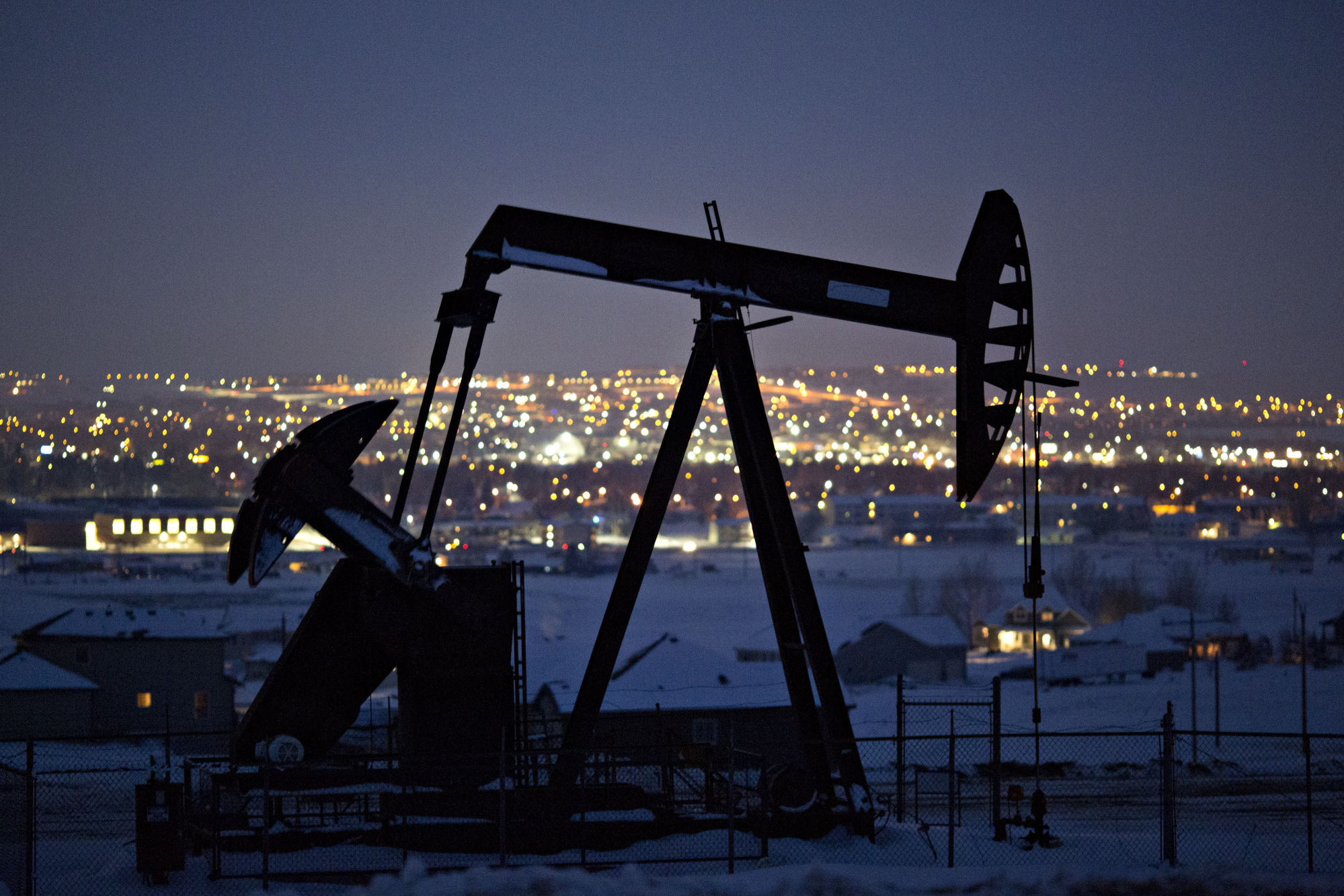 A pumpjack operates above an oil well at night in the Bakken Formation on the outskirts of Williston, North Dakota, U.S., on Thursday, March 8, 2018.