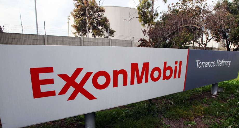 This Jan. 30, 2012, file photo, shows the sign for the ExxonMobil Torerance Refinery in Torrance, Calif.  Exxon has apparently agreed to start reporting when it spills plastic pellets, a major source of ocean pollution.