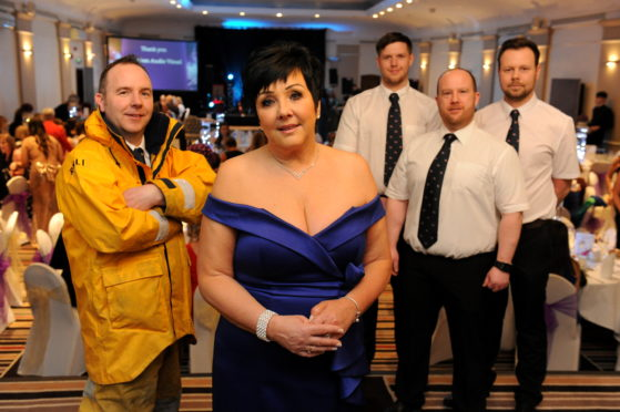 Audrey Wood, centre, with members of the RNLI crew