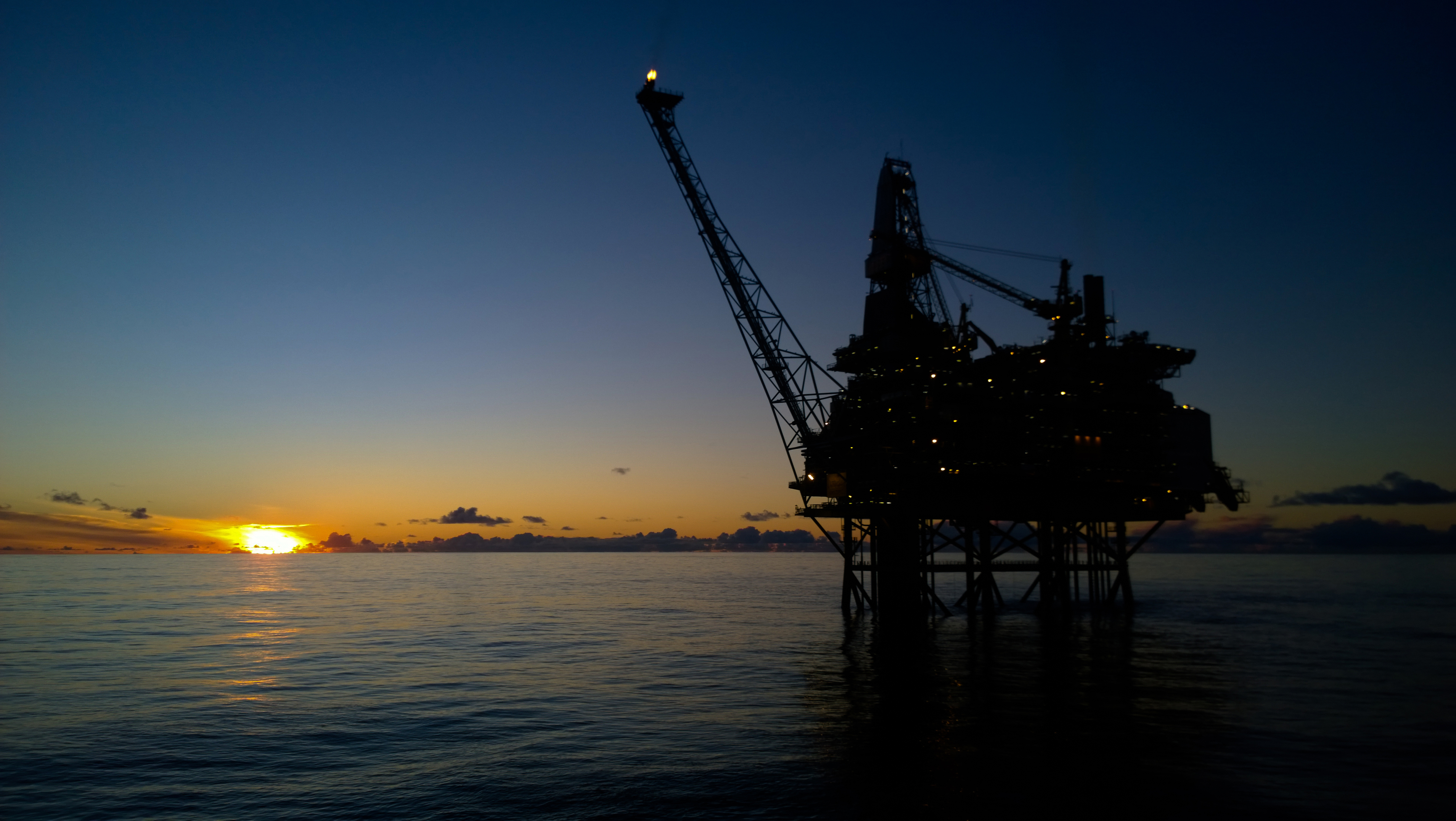 Offshore oil rig in sunset