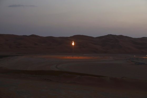 Flames burn off at an oil processing facility in Saudi Aramco's oilfield in the Rub' Al-Khali (Empty Quarter) desert in Shaybah, Saudi Arabia, on Tuesday, Oct. 2, 2018.  Photographer: Simon Dawson/Bloomberg