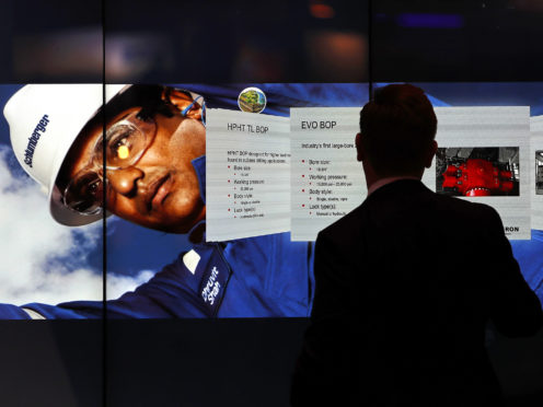 An attendee uses the Interactive Wall at the Schlumberger Ltd. booth during the 2017 Offshore Technology Conference (OTC) in Houston, Texas, U.S., on Wednesday, May 3, 2017.  Photographer: Aaron M. Sprecher/Bloomberg
