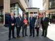 EIC CEO Stuart Broadley (left), International Trade Secretary Dr Liam Fox MP (centre-left with red folder)