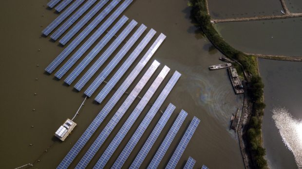 An aerial view of a water based solar farm operated by the China Energy Conservation and Environmental Protection Group on the outskirts of Jiaxing, China on Friday, 07 September 2018. Photographer: Qilai Shen