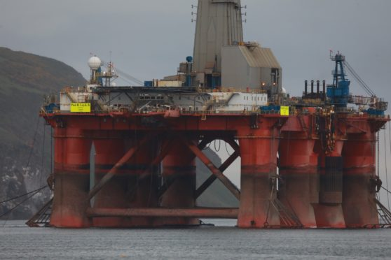 Activists scale 27,000 tonne oil rig during Highland protest