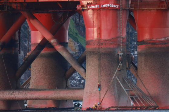 Greenpeace climbers on an oil rig in Cromarty Firth.