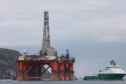 Greenpeace climbers on BP oil rig in Cromarty Firth, Scotland
