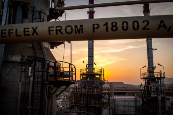 The sun sets beyond processing facilities at the Persian Gulf Star Co. (PGSPC) gas condensate refinery in Bandar Abbas, Iran, on Wednesday, Jan. 9. 2019. The third phase of the refinery begins operations next week and will add 12-15 million liters a day of gasoline output capacity to the plant, Deputy Oil Minister Alireza Sadeghabadi told reporters. Photographer: Ali Mohammadi/Bloomberg