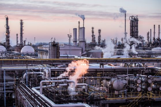 Oil processing and refining structures stand in the Duna oil refinery, operated by MOL Hungarian Oil & Gas Plc, in Szazhalombatta, Hungary, on Wednesday, February 13, 2019.