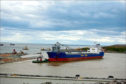"""A ship got stuck in the new Harbour at Nigg Bay.  Sent in by From: Richard Sutherland  rfsutherland@aol.com  7715679491   """"New harbour at Bay of Nigg. The reason the ship berthed for so long was it had hit the bottom"""""""