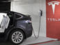 A Tesla power station with a Model X in a car park near Tesla store at Fressgasse in the City of Frankfurt/ Main 11th August 2017 Alex Kraus/ Bloomberg News Photographer: Alex Kraus/ Bloomberg News