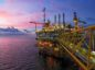 An offshore rig in twilight
