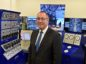 Paul de Leeuw standing in front of RGU's decommissioning simulator.
