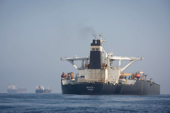 A view of the Grace 1 supertanker at anchor in the British territory of Gibraltar, Thursday, Aug. 15, 2019, seized last month in a British Royal Navy operation off Gibraltar.  The United States moved on Thursday to halt the release of the Iranian supertanker Grace 1, detained in Gibraltar for breaching EU sanctions on oil shipments to Syria, thwarting efforts by authorities in London and the British overseas territory to defuse tensions with Tehran.(AP Photo/Marcos Moreno)
