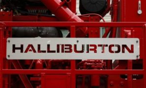 Impairments cut Halliburton's pre-tax earnings in half