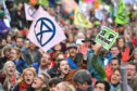 Protesters sitting down outside the Ministry of Justice in Westminster, London, during an Extinction Rebellion (XR) climate change protest. PA