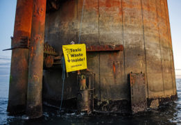Breaking: Greenpeace leave 'toxic waste' scrawl as they quit Shell's Brent Bravo