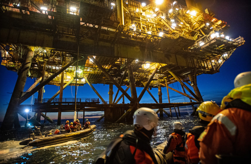 Brent protest. Two activists climbed the Brent alpha, while another two boarded the legs of the Brent Bravo. Pic: Greenpeace