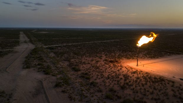 A large flare can be seen in this aerial photograph taken near Mentone, Texas, U.S., on Saturday, Aug. 31, 2019. Photographer: Bronte Wittpenn/Bloomberg