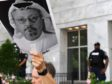 WASHINGTON, DC - OCTOBER 10: Michael Beer holds a poster during a rally about the disappearance of Washington Post journalist, Jamal Khashoggi outside the Embassy of Saudi Arabia on Wednesday October 10, 2018 in Washington, DC. Khashoggi disappeared after entering the Saudi Consulate in Instanbul. (Photo by Matt McClain/The Washington Post via Getty Images)